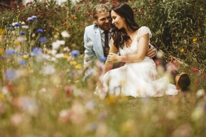 Bride and groom amongst the wildflowers at Sheffield Manor Lodge wedding venue