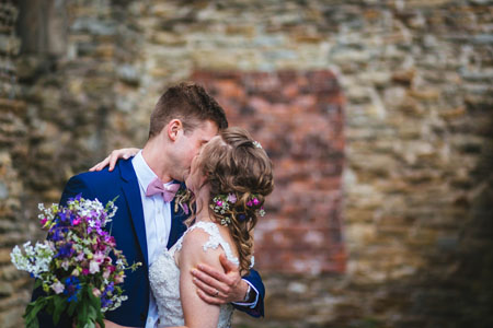 Happy wedding couple's first kit in the romantic ruins of Sheffield Manor Lodge