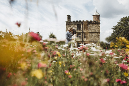 Wedding couple in the Manor Lodge wildflowers