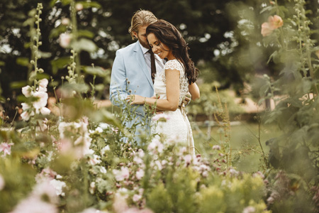 Wedding couple in the wildflowers