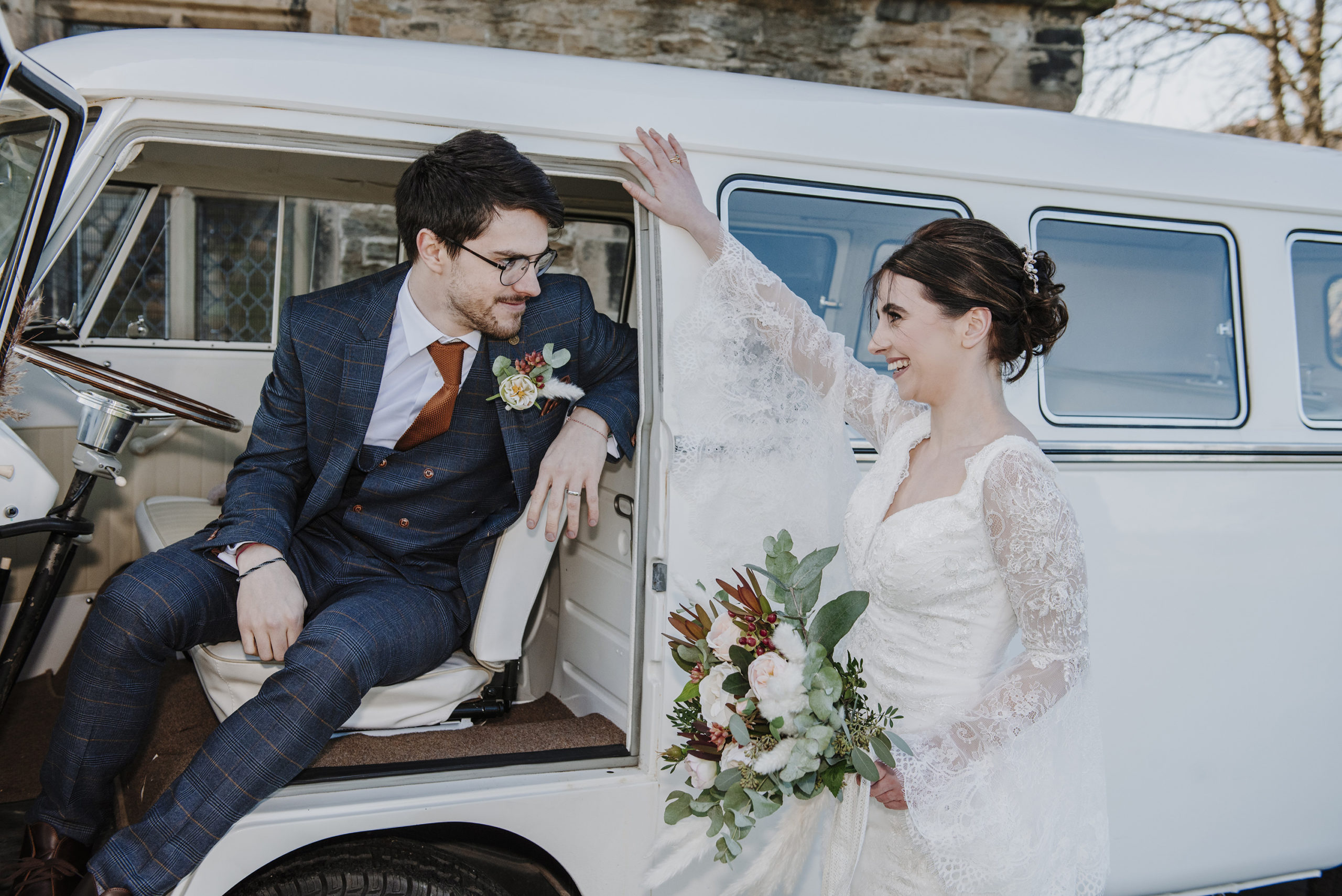 Bride and groom travel in a rustic campervan to their wedding
