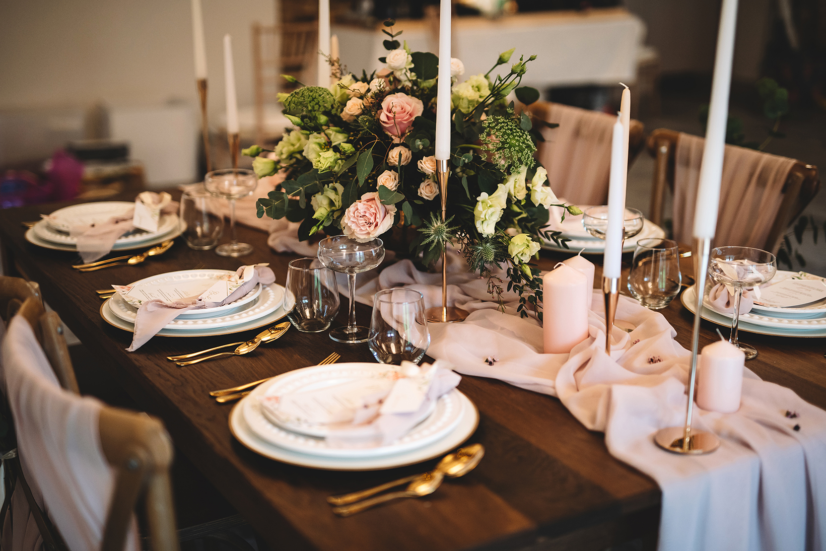 Table dressed by Samui for awedding at Manor Oaks House. Pink rustic flowers and soft styling for a romantic farm house feel