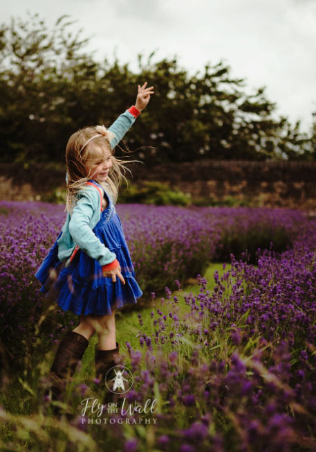 Little girl playing in Lavender at sheffield manor lodge